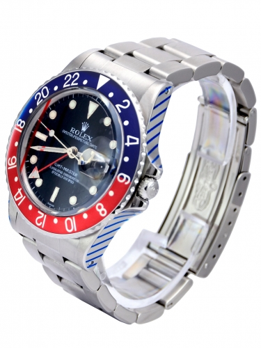 Side view image of a beautifully aged vintage Rolex GMT-Master 16750 Pepsi