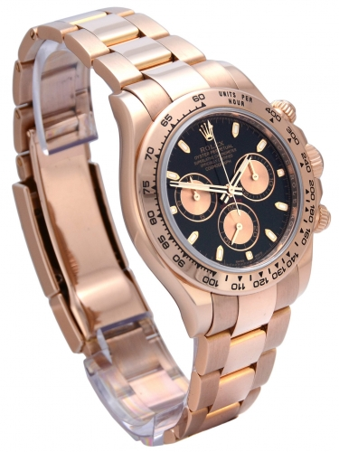 Side view of rose gold Rolex Daytona 116505 with a black dial and everose gold subdials