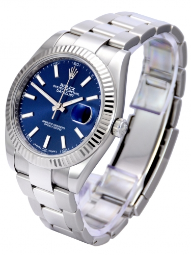 Side view image of a stainless steel Rolex Datejust 126334 with a blue baton dial and a white gold fluted bezel