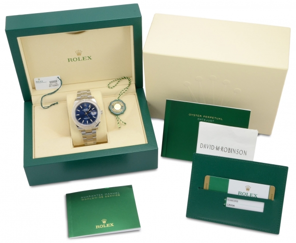 Box & papers of a stainless steel Rolex Datejust 126334 with a blue baton dial and a white gold fluted bezel