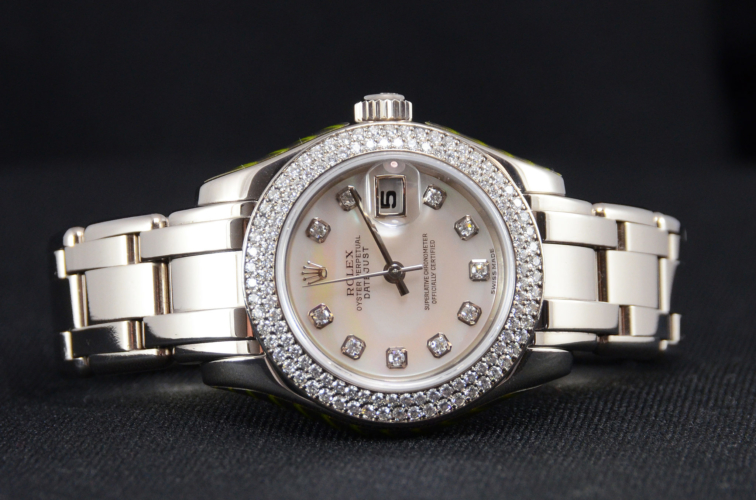 Detail view of a white gold 29mm Rolex Pearlmaster 80339, with a diamond set bezel and a white mother of pearl diamond dot dial