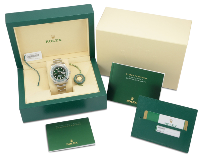 """Box and papers image of a stainless steel Rolex Submariner Date 116610LV """"Hulk"""" with a green sunburst effect dial and green bezel"""