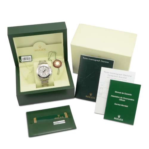 Box & papers view image of a NOS Rolex Daytona 116520