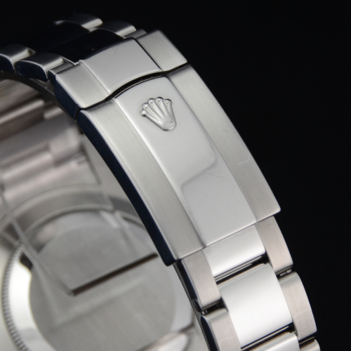 Detailed image of the Oysterclasp folding clasp of a unique 2012 golf competition trophy Rolex Datejust II 116334 with a dark grey Roman numeral dial, on an Oyster bracelet