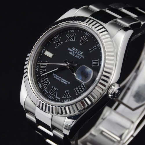Detailed image of the face of a unique 2012 golf competition trophy Rolex Datejust II 116334 with a dark grey Roman numeral dial, on an Oyster bracelet