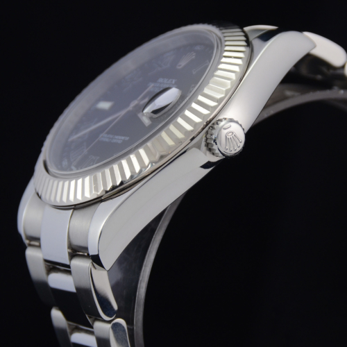 Detailed image of case side and crown of a unique 2012 golf competition trophy Rolex Datejust II 116334 with a dark grey Roman numeral dial, on an Oyster bracelet